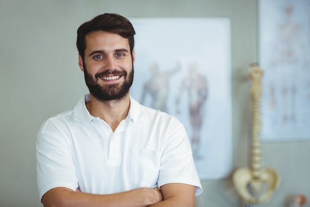 Portrait of physiotherapist standing with arms crossed