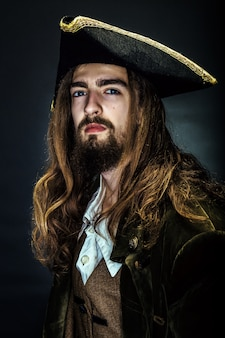 Portrait of a pirate on black space.