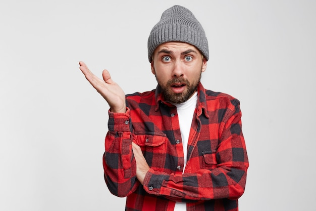 Portrait of pissed off frustrated european guy in checkered shirt