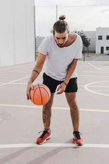 Portrait of a player dribbling basketball