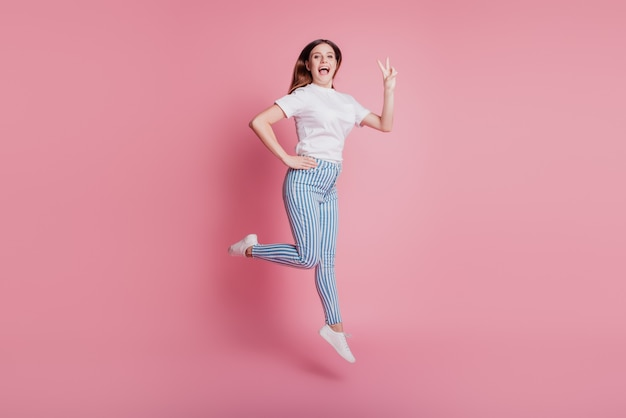 Portrait of playful crazy girl jumping in the air hurry run sale shopping season