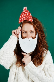 Portrait of playful girl celebrating christmas