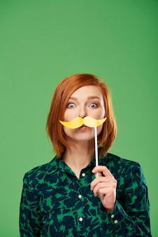 Portrait of playful woman with mustache