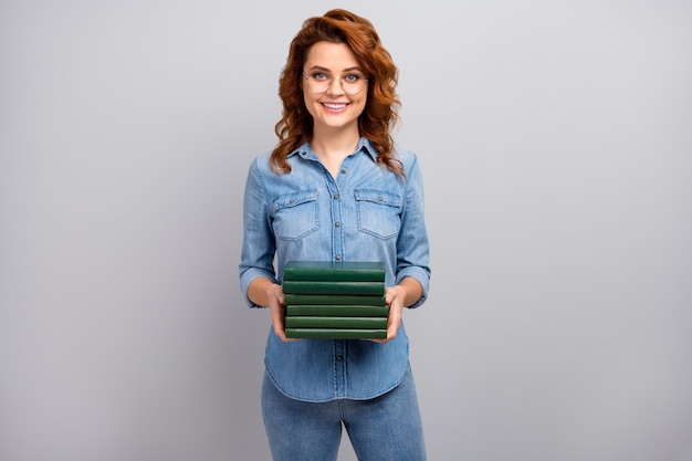 Portrait of positive cheerful woman high school librarian hold pile stack books prepare exam courses wear good look outfit isolated over grey color wall