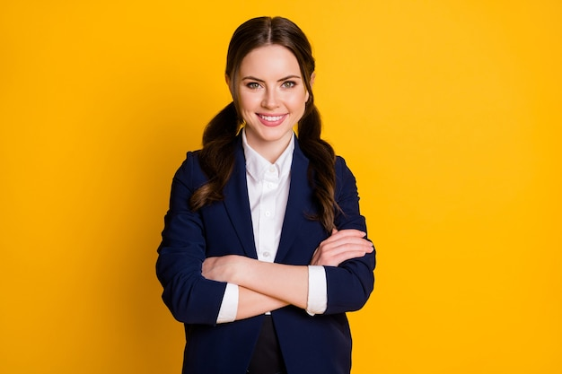 Portrait of positive confident high school lady cross hands smile