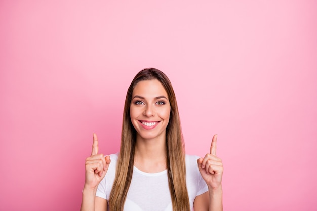Portrait of positive cool girl point index finger up copyspace suggest select adverts promo wear casual style clothes