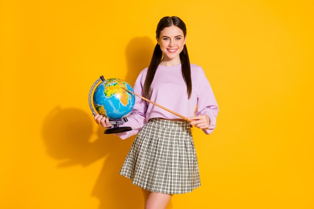 Portrait positive girl geography teacher hold globe point africa continent