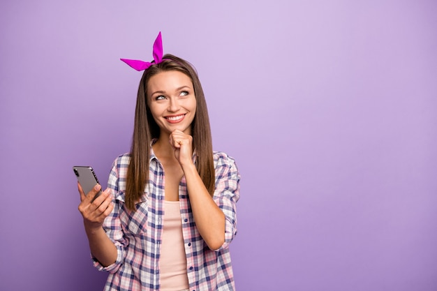 Portrait of positive inspired girl use smartphone think