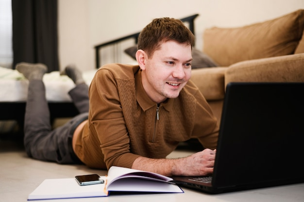 Portrait of positive male working from home