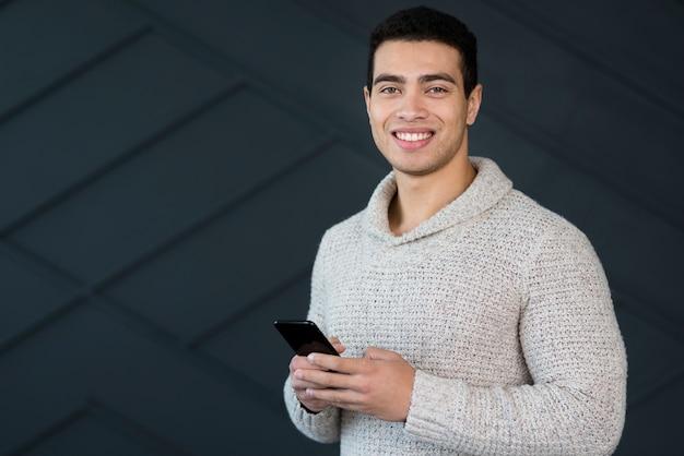 Portrait of positive man smiling