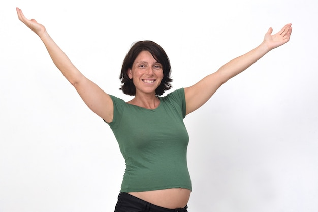 Portrait of a pregnant woman with open arms
