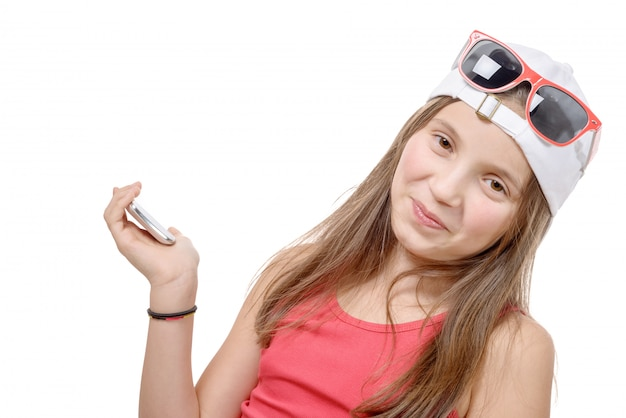 Portrait of a preteen girl with a phone