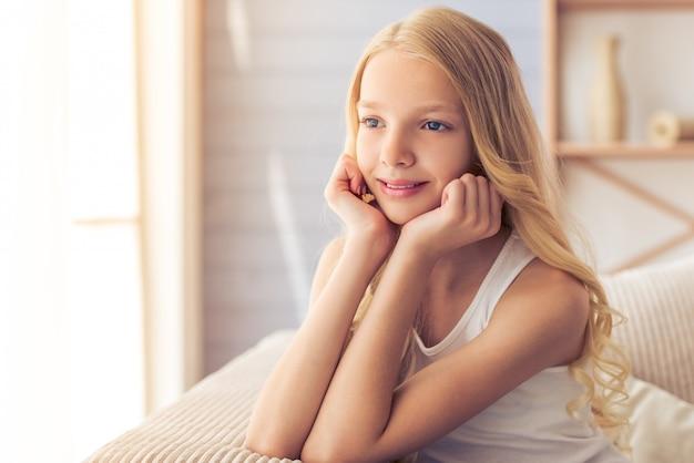 Portrait of pretty blonde teenage girl smiling.