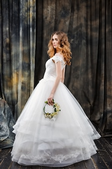 Portrait of pretty bride in wedding dress