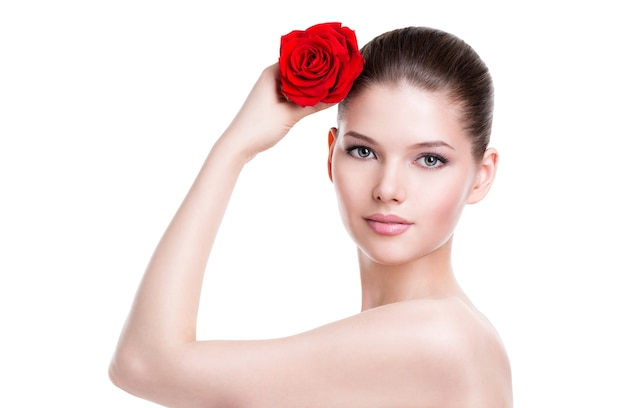 Portrait of pretty face of beautiful woman with a red rose - isolated on white.
