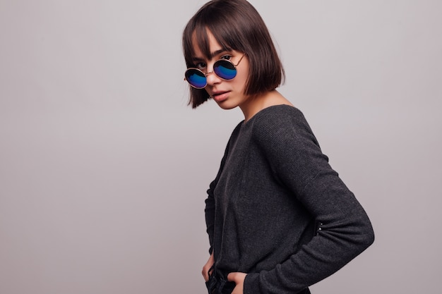 Portrait of pretty girl teenager in sunglasses isolated.