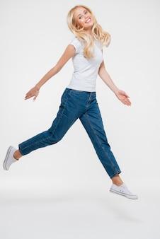 Portrait of a pretty joyful woman jumping