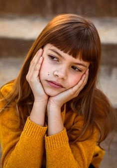 Portrait of pretty little girl being bored