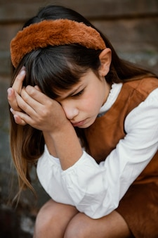 Portrait of pretty little girl being sad