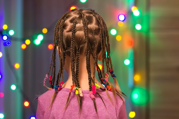 Portrait of pretty little girl with hair braids