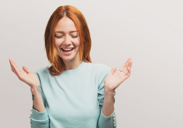 Portrait of a pretty redhead girl laughing