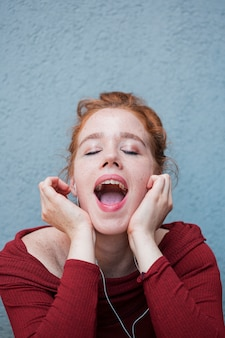 Portrait of pretty redhead woman