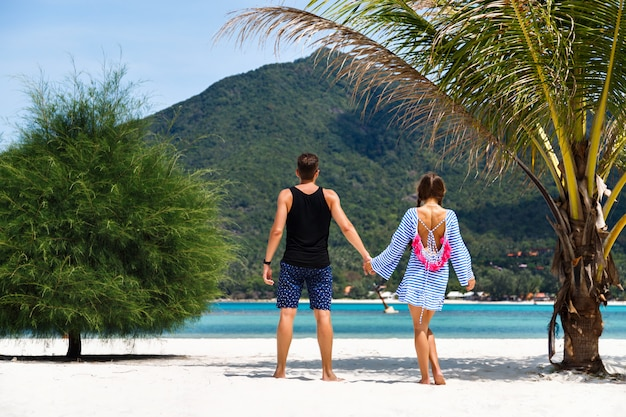Portrait of pretty romantic couple having fun at tropical islands