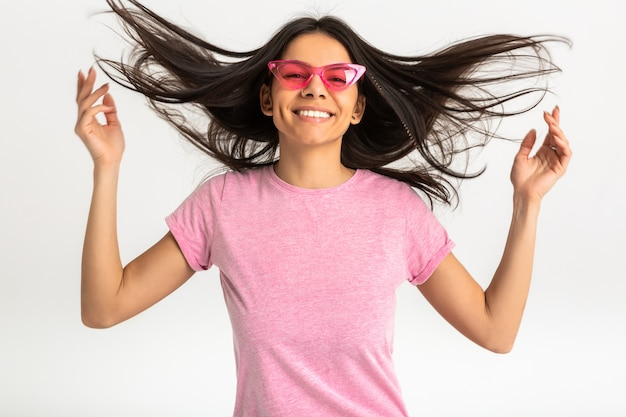 Portrait of pretty smiling emotional woman in pink shirt and stylish sunglasses, white teeth, positive posing isolated, long hair