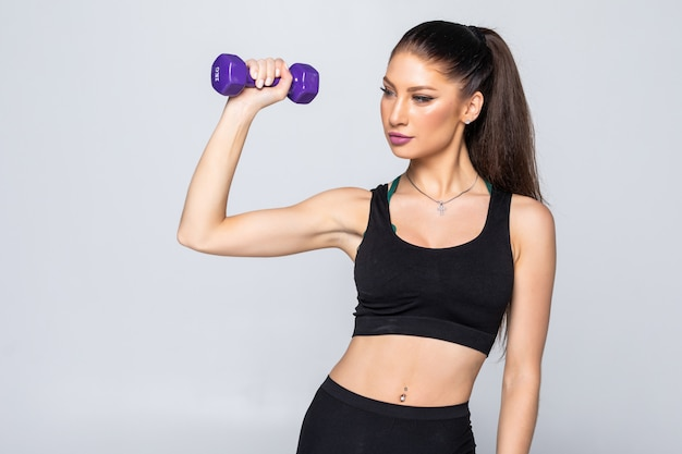 Portrait of pretty sporty woman holding weights dumbbells isolated