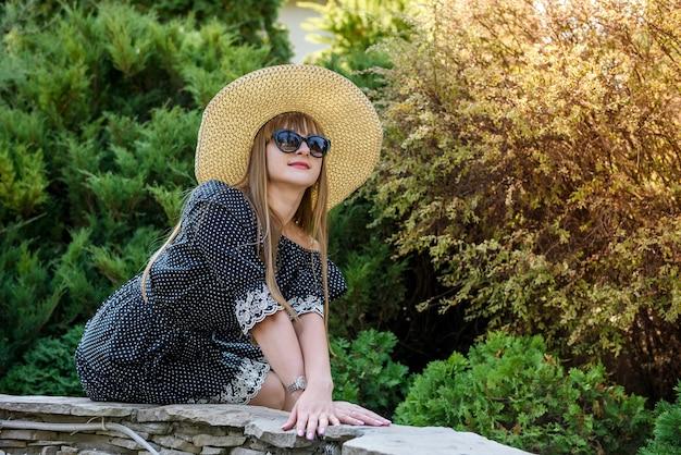 Portrait of pretty woman in summer garden, lifestyle
