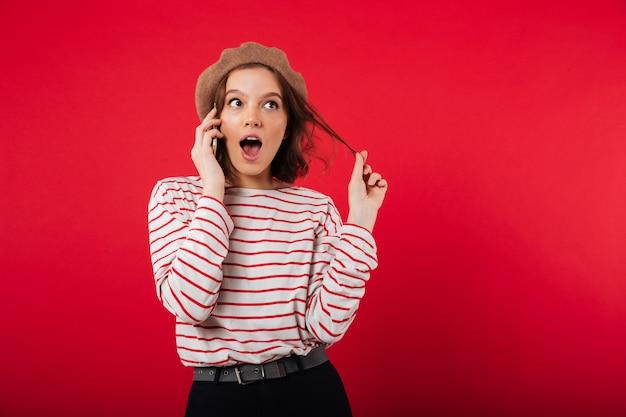 Portrait of a pretty woman wearing beret talking