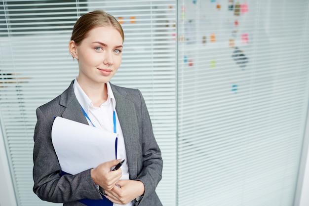 Portrait of pretty woman worker