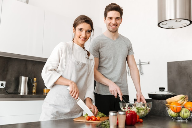 Portrait of a pretty young couple cooking together