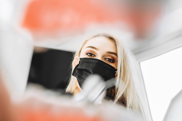 Portrait of the pretty young female dentist in a dental clinic.