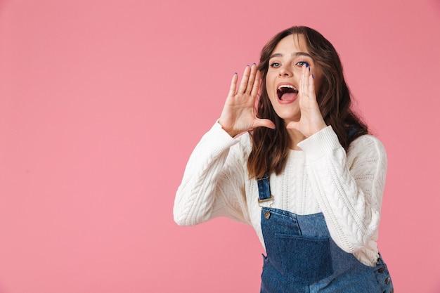 Portrait of a pretty young woman shouting loud