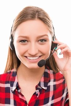 Portrait of pretty young worker in call center