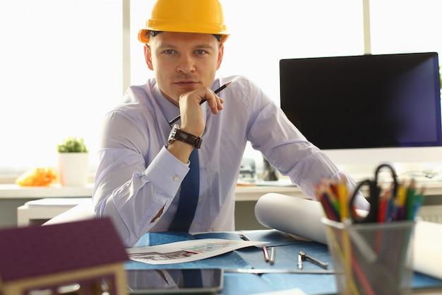 Portrait of professional engineer in helmet