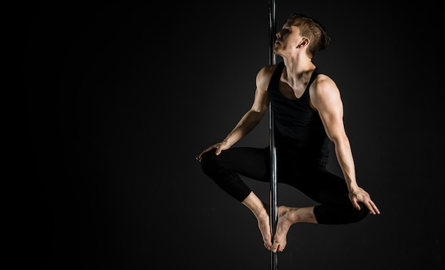 Portrait of professional pole dancer male