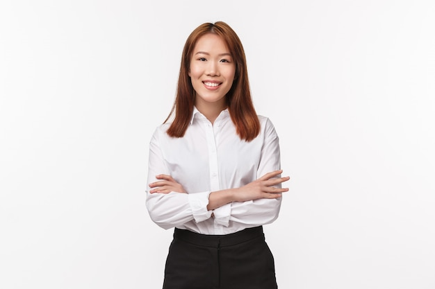 Portrait of professional smart and creative lady boss, female entrepreneur in white elegant shirt, cross hands over chest and smiling satisfied, run successful business,