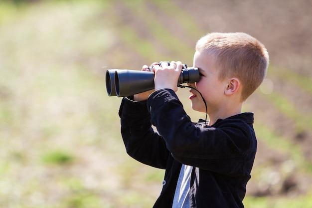 Portrait in profile of little handsome cute blond boy