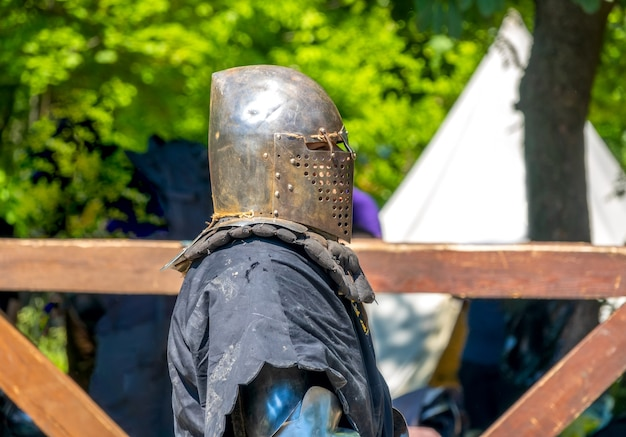 Portrait in profile of a medieval soldier in an iron helmet