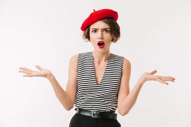 Portrait of a puzzled woman wearing red beret