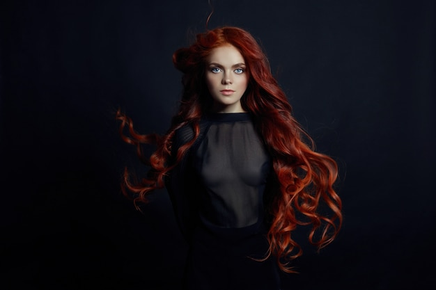 Portrait of redhead sexy woman with long hair