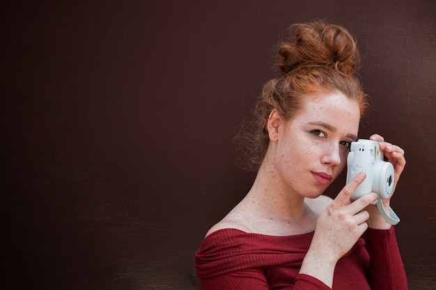 Portrait of redhead woman with copy space