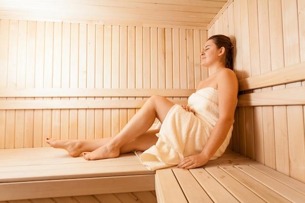 Portrait of relaxing women in wooden sauna