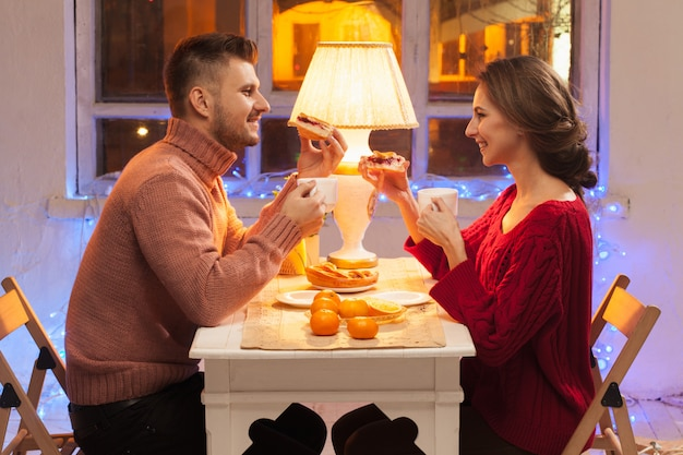 Portrait of romantic couple at valentine's day dinner with candles