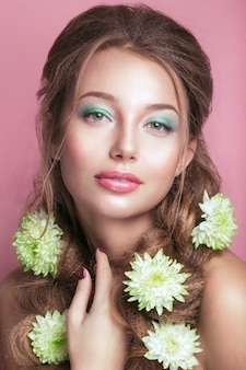 Portrait of romantic young woman with green flower and makeup looking .  spring fashion photo. inspiration of spring and summer.