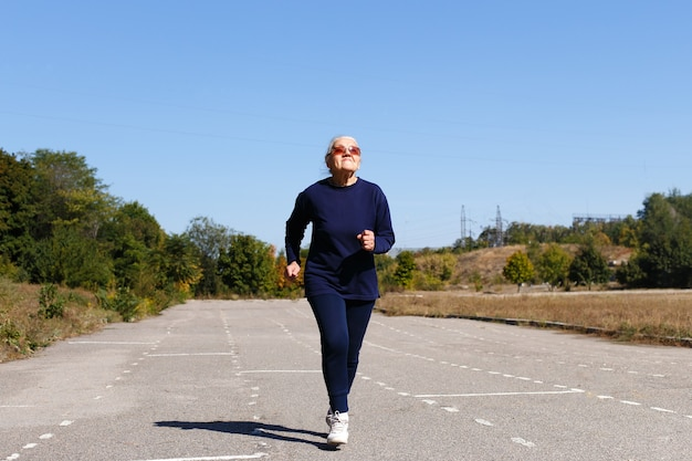Portrait of a runner woman in sportswear and sunglasses.