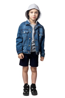 Portrait of sad boy in denim jacket,  cry and is very afraid on white isolated background