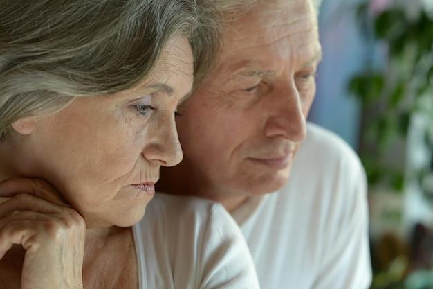 Portrait of a sad senior couple at home
